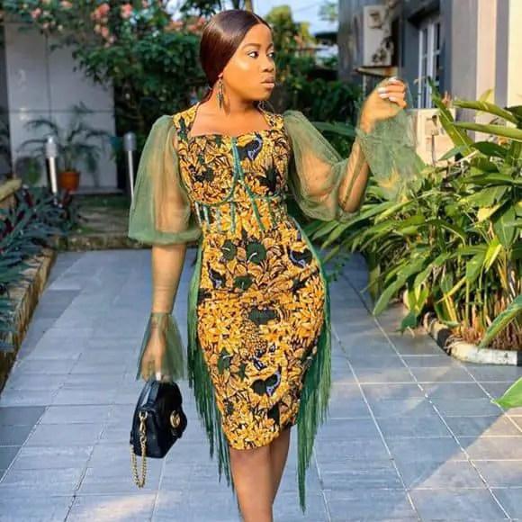 lady in ankara dress with green net sleeves