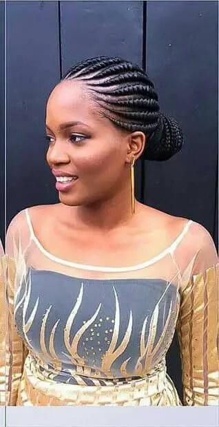 lady rocking black weaves Ghana weaving