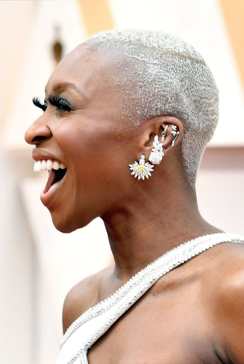 smiling lady wearing silver dyed hair