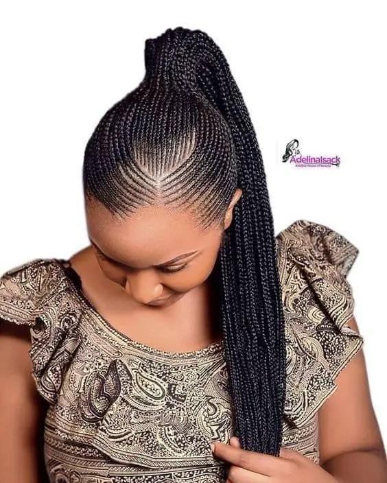 lady rocking tiny Ghana weaving