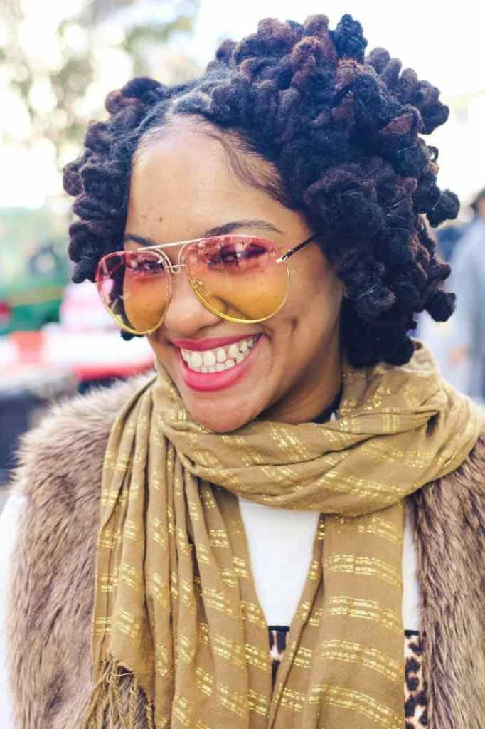 smiling lady with glasses wearing short black dreads