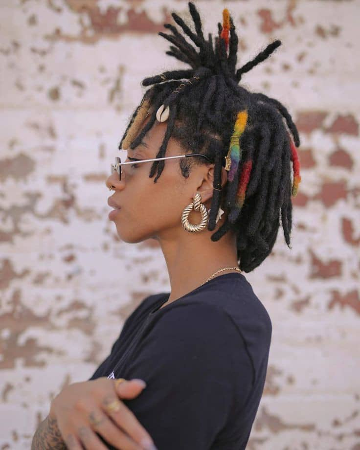 lady wearing short colored dreads