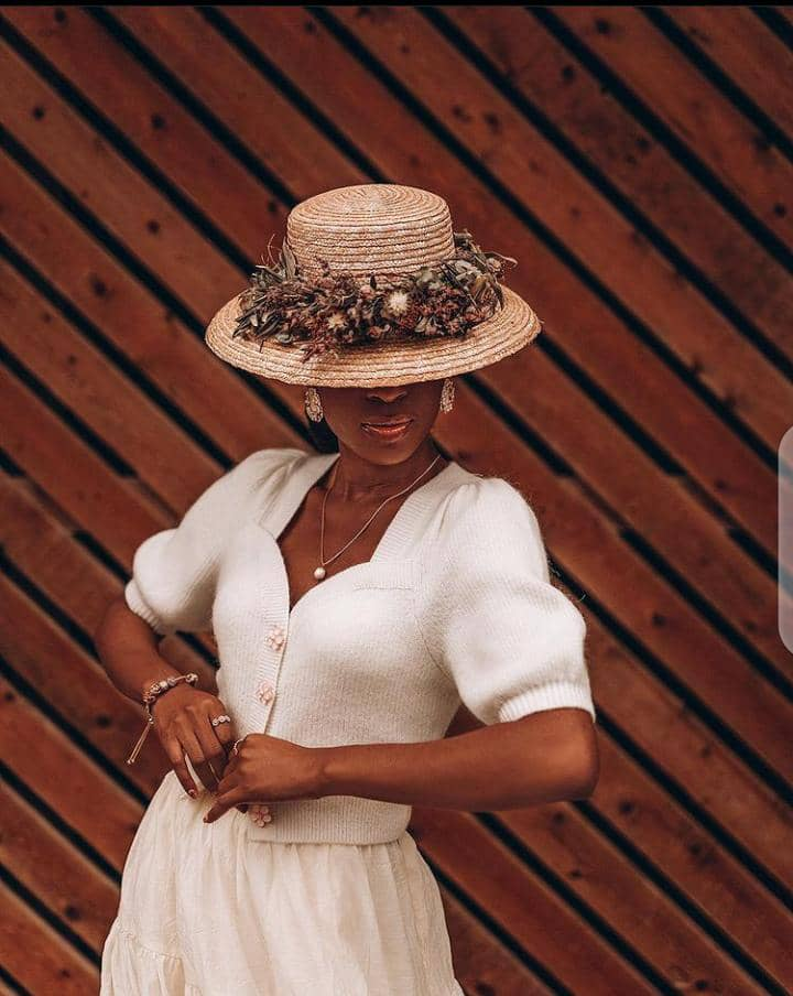 lady wearing statement hat