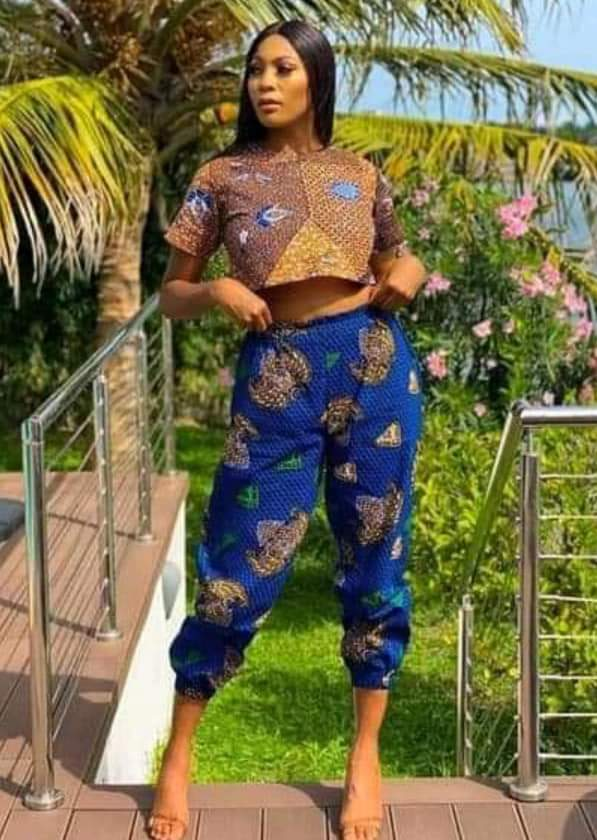 lady wearing different ankara prints top and trouser