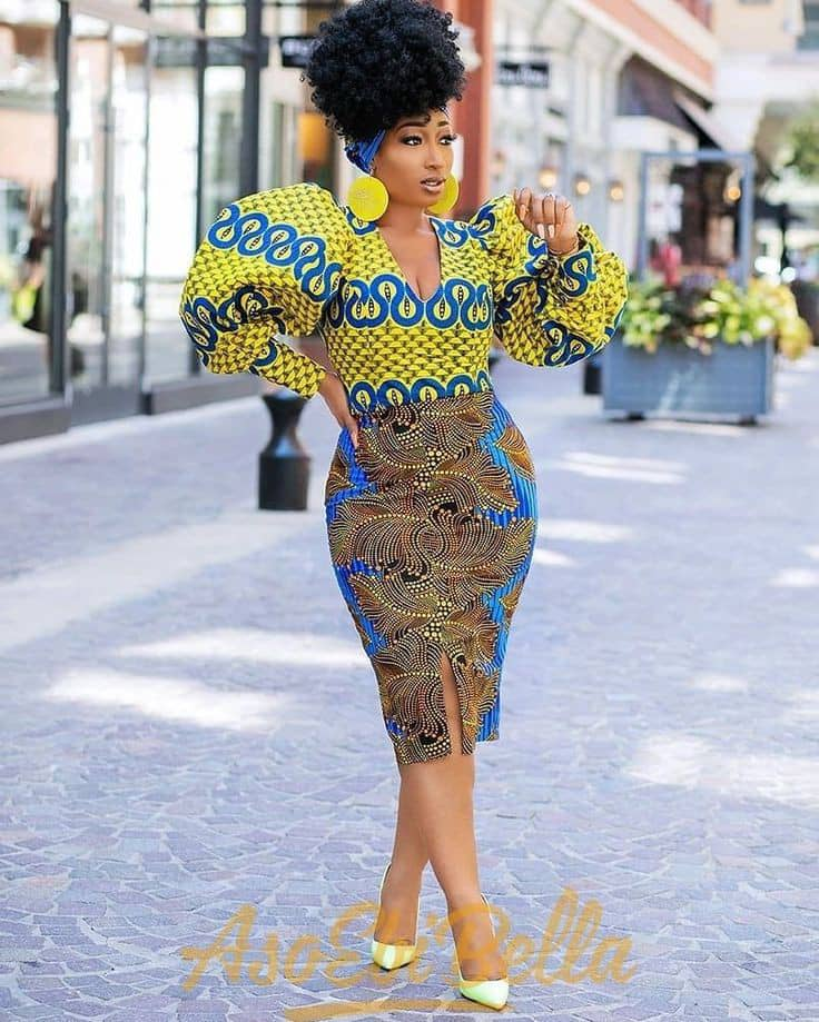 lady wearing different ankara blouse and skirt