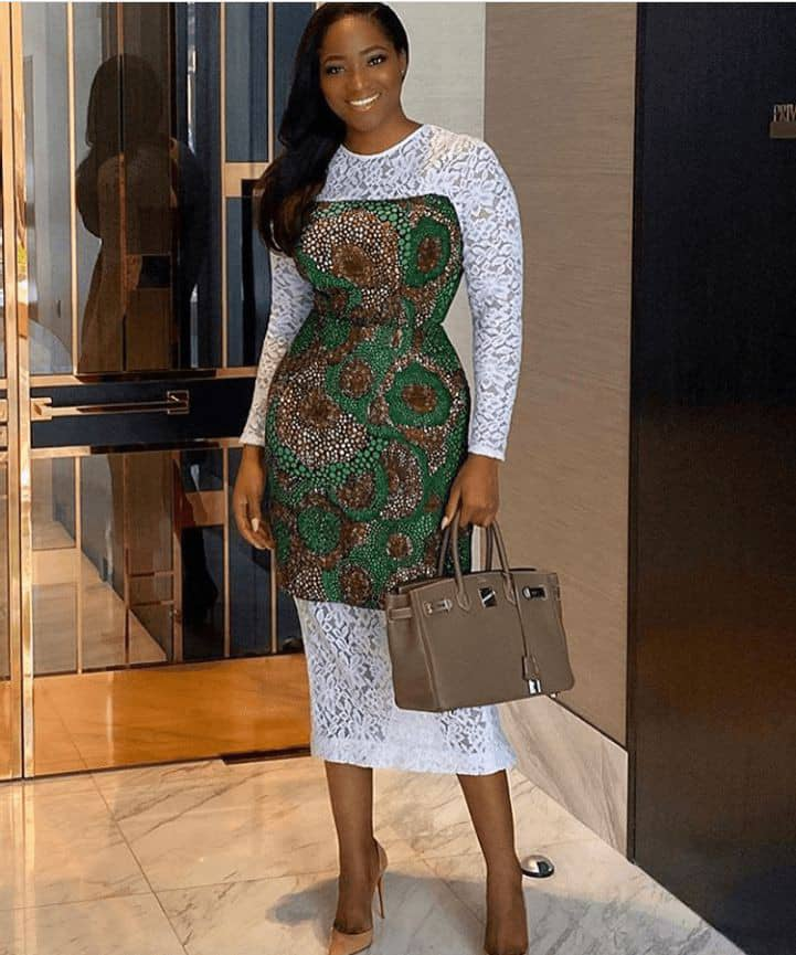 lady's dress combines ankara and white lace