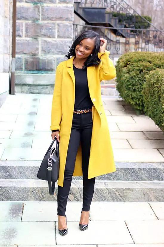 smiling lady wearing yellow overcoat