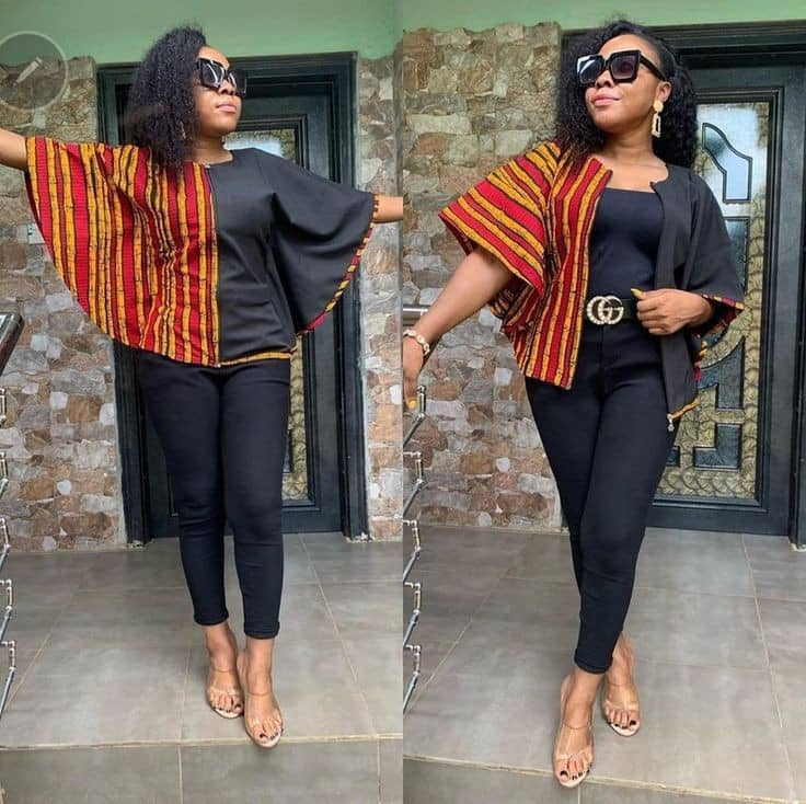 lady wearing black top combined with ankara