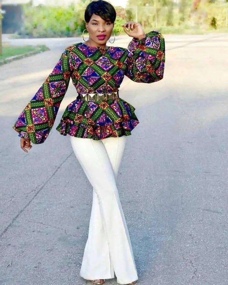 lady wearing long sleeves ankara peplum top with white pants