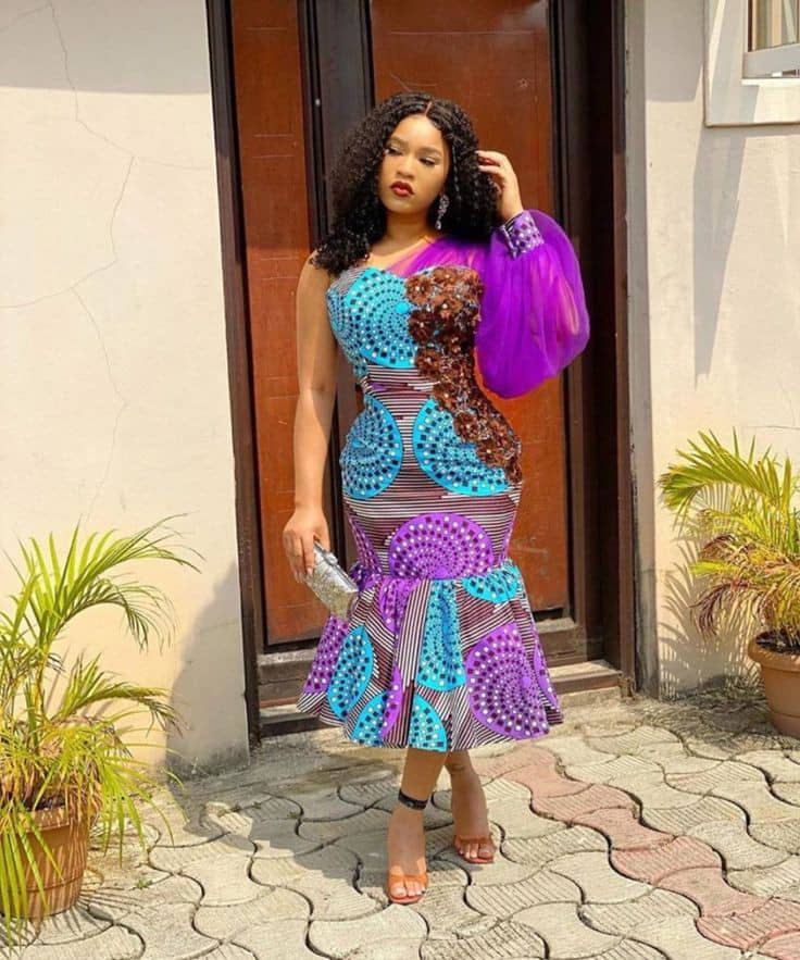 lady wearing ankara and organza midi dress