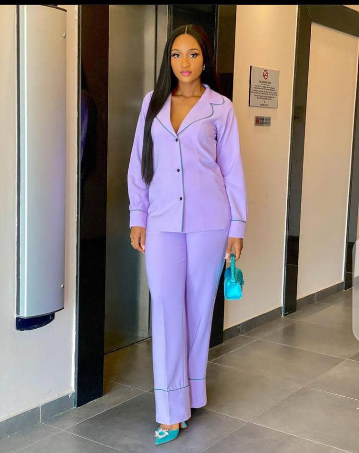 lady in colorful suit and pants
