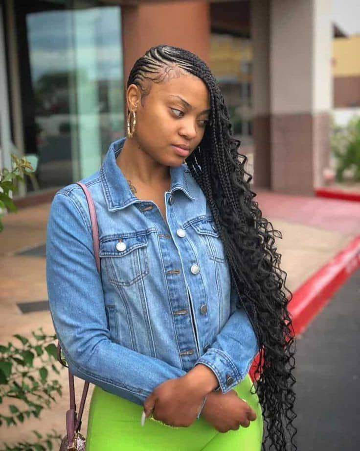 lady in curly cornrows and jeans jacket