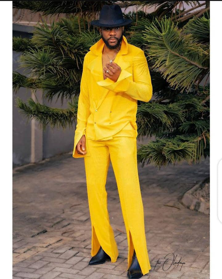 Ebuka in a yellow outfit with black hat and shoes