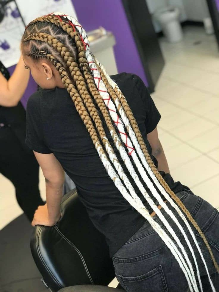 lady wearing gold and white cornrows