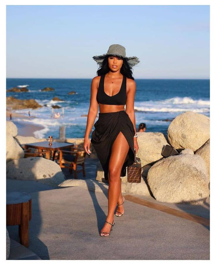 lady wearing hat on outfit for the beach