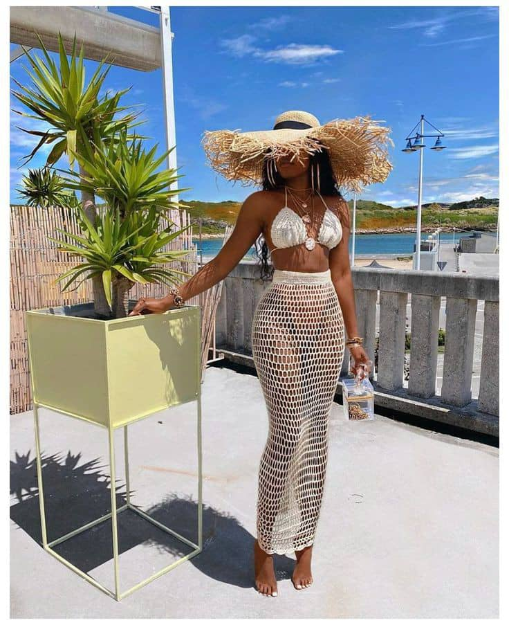 lady rocking bikini and wide brimmed hat