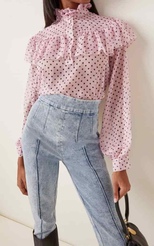 lady wearing jeans with polka dots top