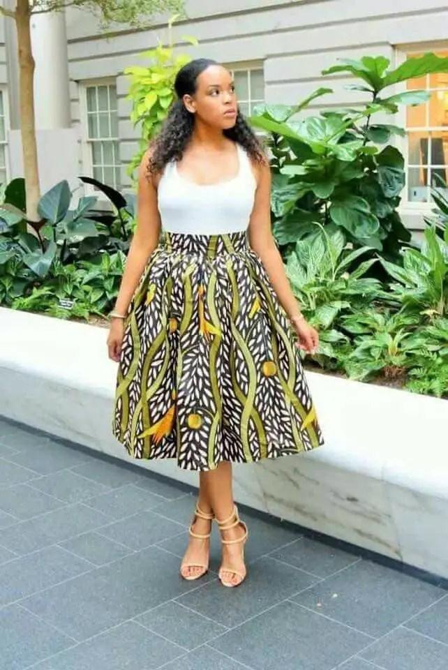 fair lady wearing white top with ankara skirt