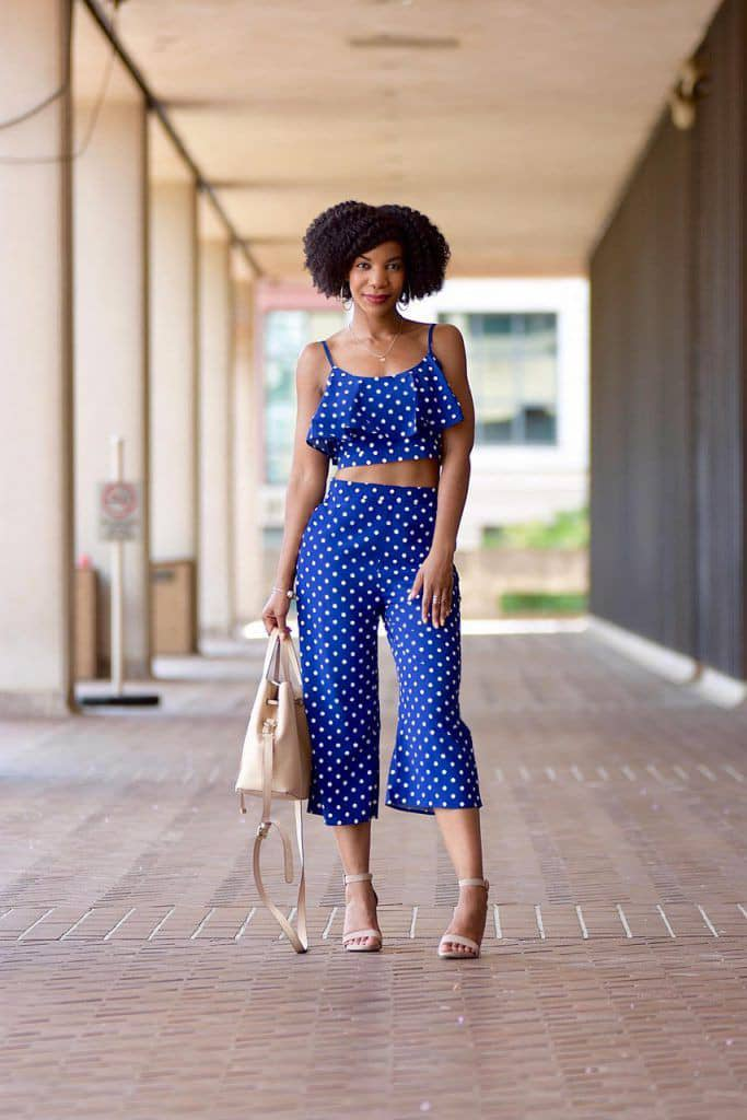 lady wearing up and down polka dots outfit