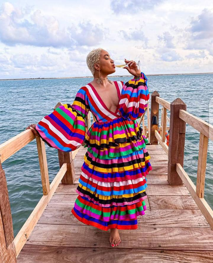 lady wearing multi colored dress