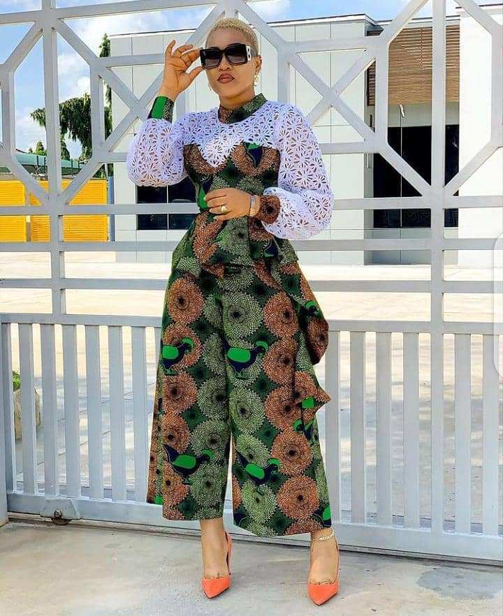 lady wearing mixed print ankara jumpsuit