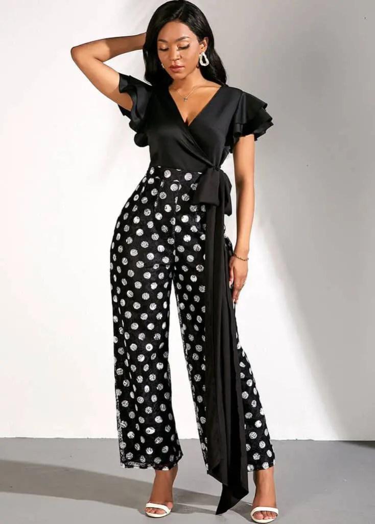 lady wearing polka dots pants with plain black top