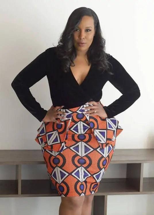 lady wearing ankara peplum skirt with black top