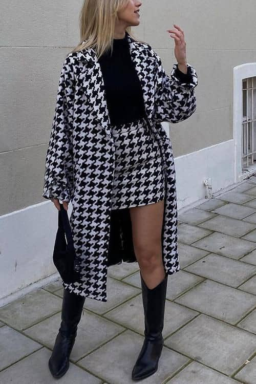 lady wearing to-match long jacket and mini skirt with knee-high boots