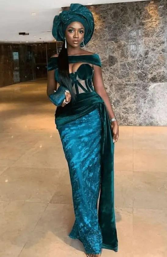 Tiwa Savage rocking green lace dress for owambe