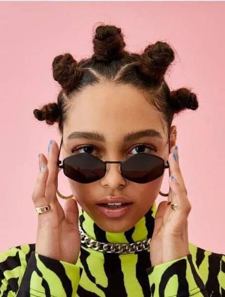lady rocking Bantu knots with dark shades