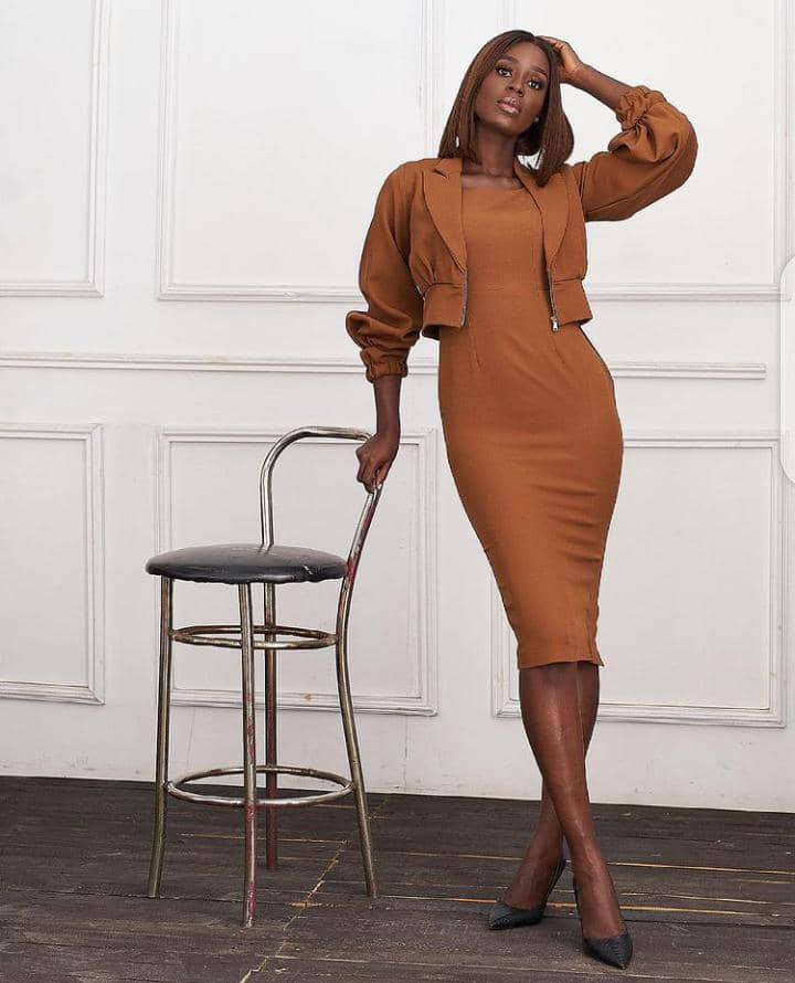 lady dressed in a brown dress for work
