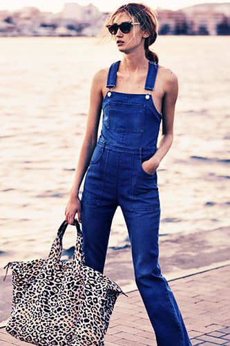lady wearing dungaree without top