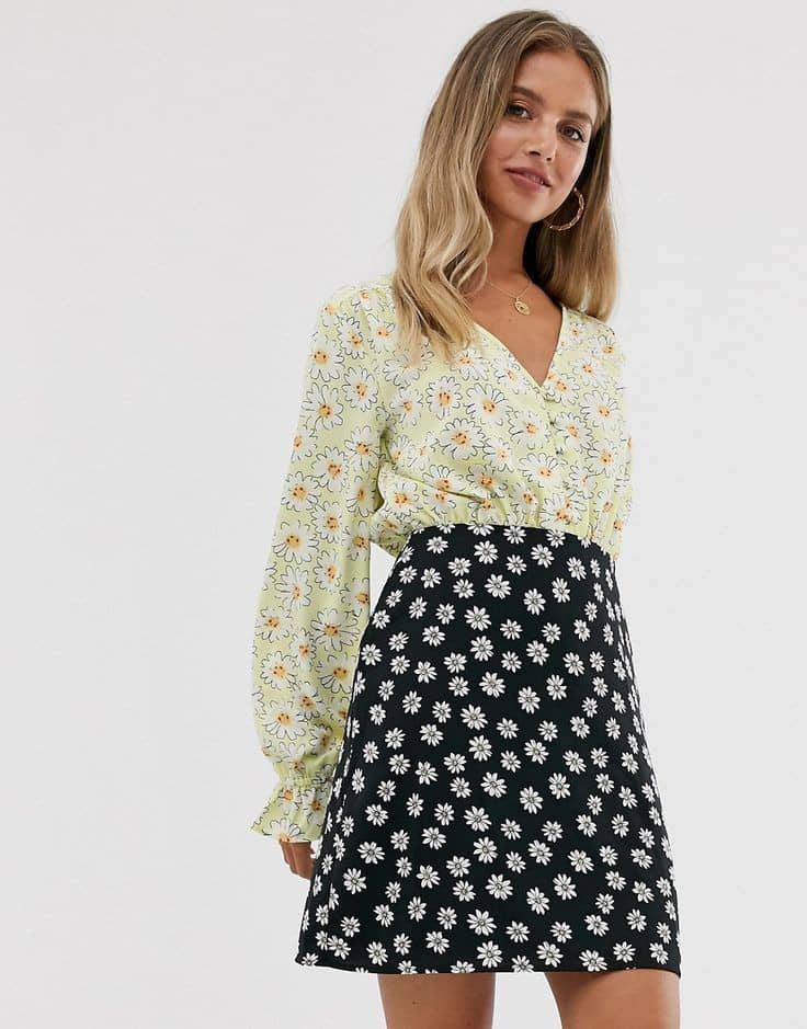 lady wearing flowery patterned shirt with flowery patterned short skirt