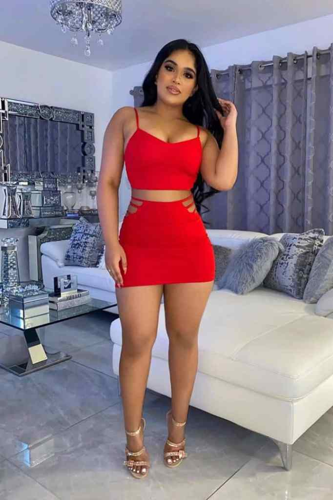 lady wearing red matching set top and mini skirt with heels