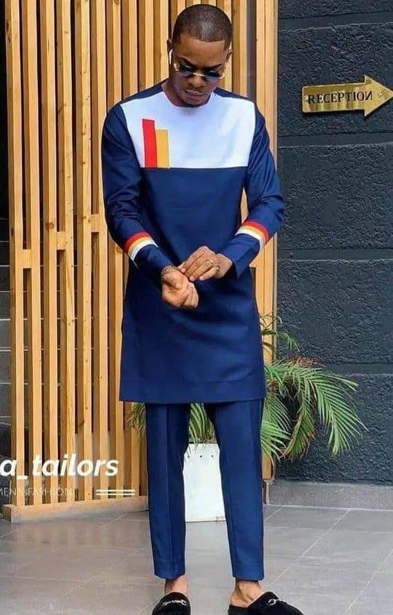 guy wearing navy blue senator wear