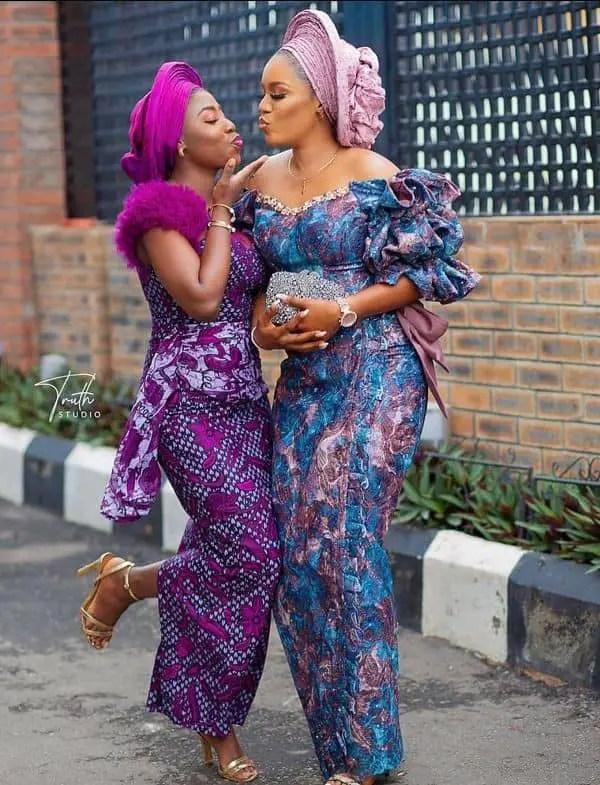 2 ladies wearing owanbe dresses with gele