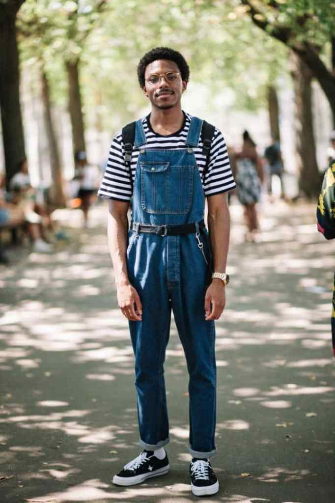 man wearing dungaree with a tshirt