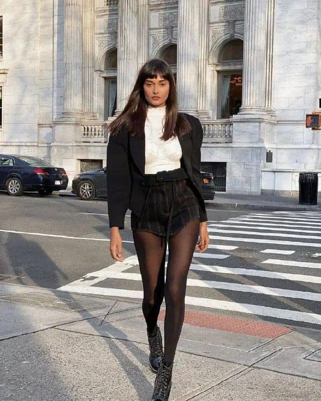 lady wearing sheer tight under black mini skirt