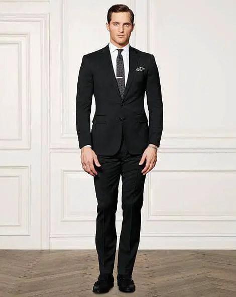 man wearing dark suit and tie