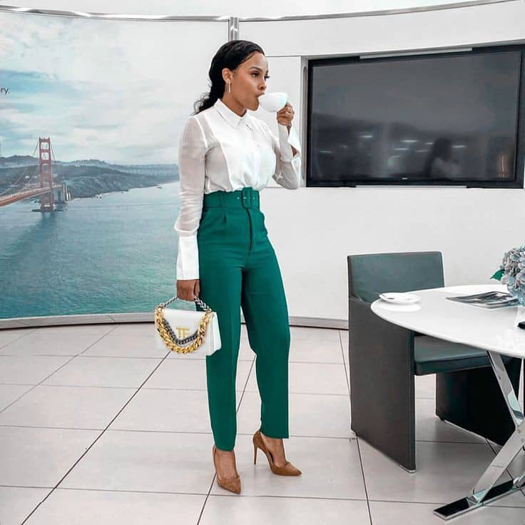 lady in white shirt and green formal pants at work