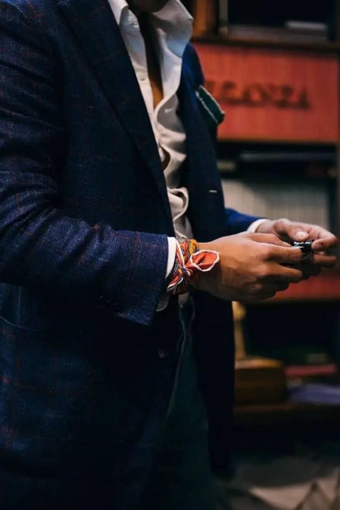 man wearing scarf on his wrist