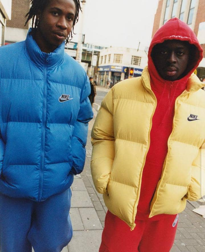 2 men in colorful winter jackets