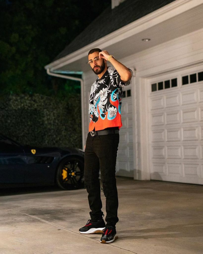 Karim Benzema in a stylish outfit posing for a shot