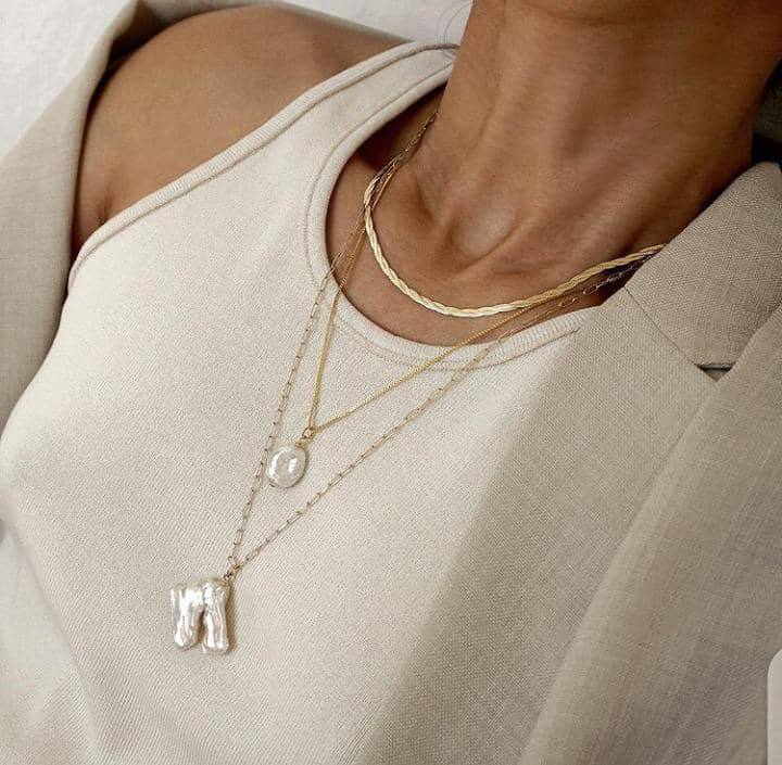lady layering necklaces