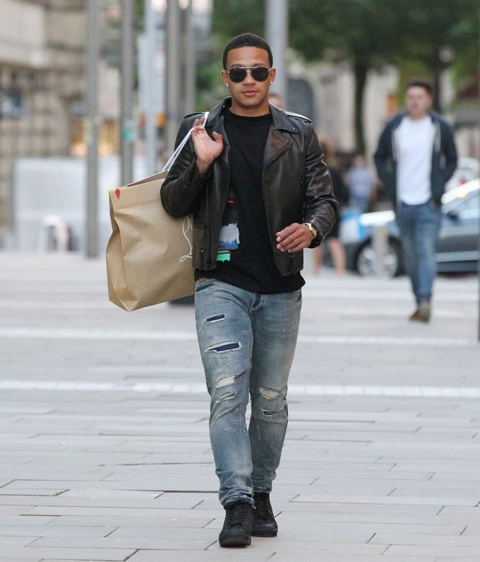 Memphis Depay in a casual outfit