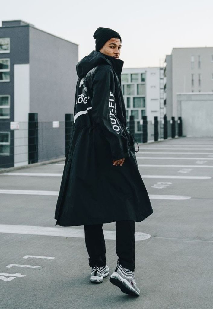 Serge Gnabry donning long overcoat