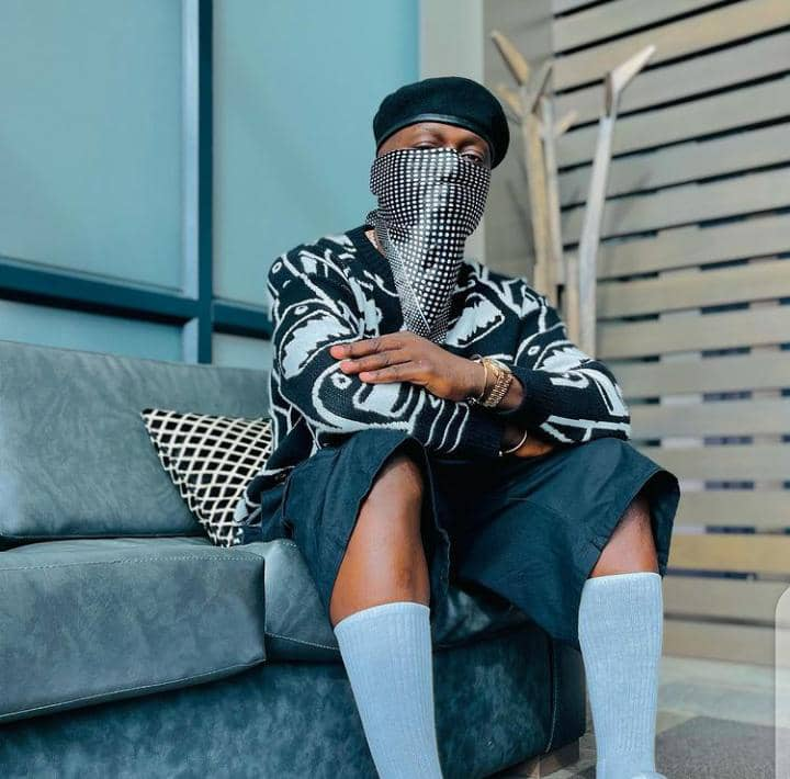DJ Spinall in streetwear outfit