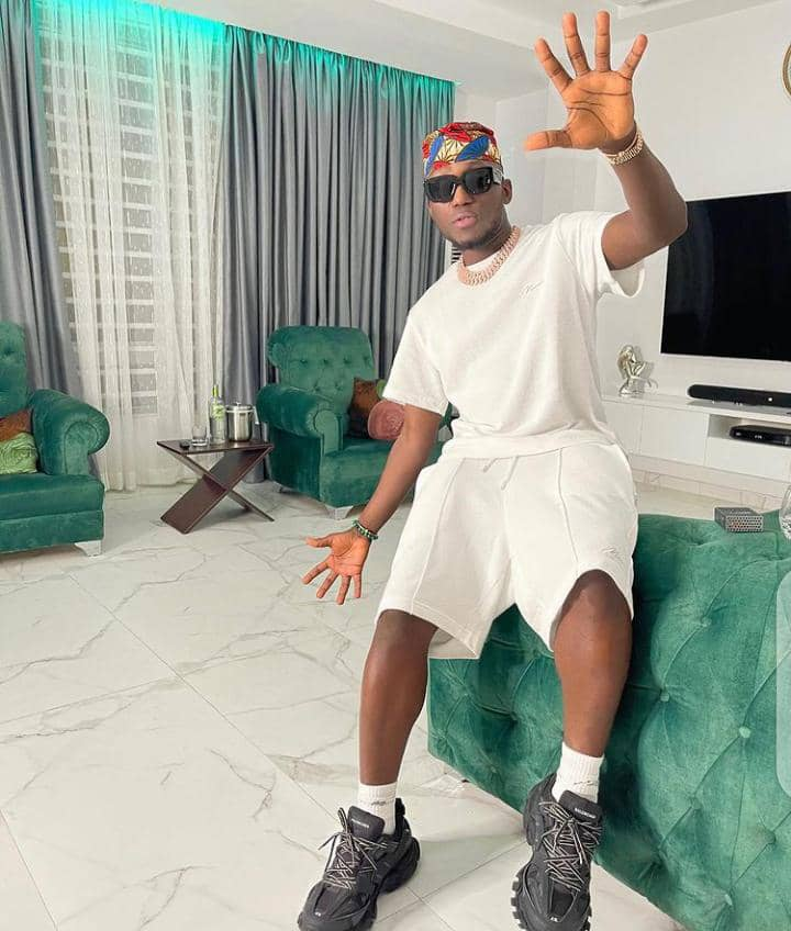"""DJ Spinall rocking his """"the cap"""" style"""