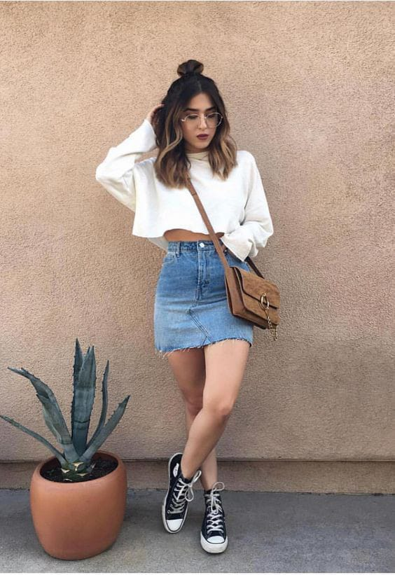 lady wearing white top and jean skirt