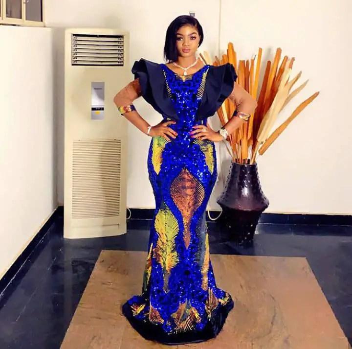 lady wearing ankara dress with lace